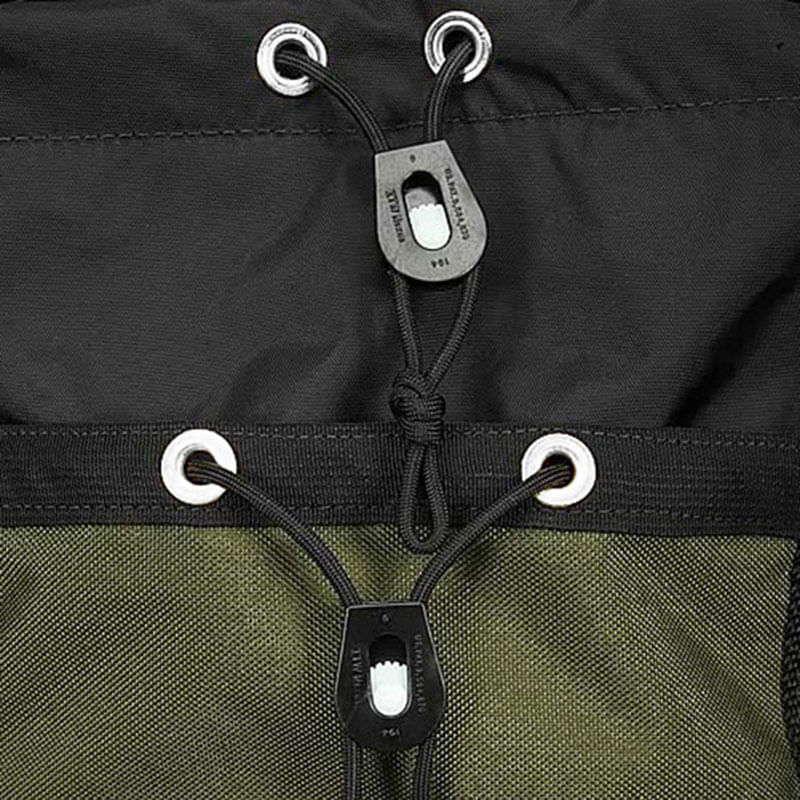 Stainless steel grommets and tension locks help secure the skirt and top of the bag