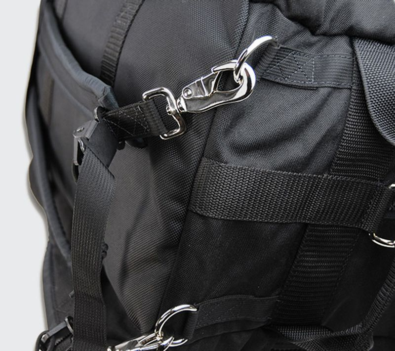 Stow away back pack straps hook to reinforced d-rings